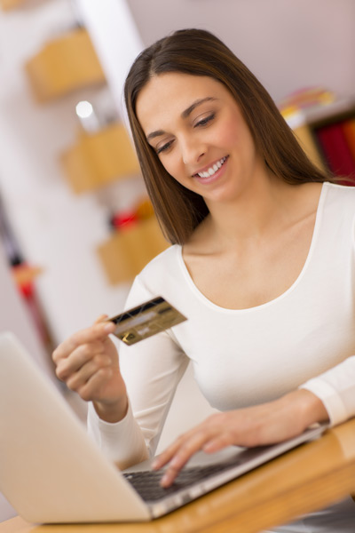 Photo of girl paying online by card.